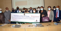 Presentation of N162.5557 Billion 2020 Sovereign Sukuk Symbolic Cheque to Federal Ministry of Works and Housing